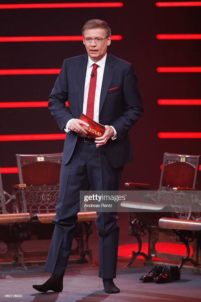 TV host Guenther Jauch moderates without his shoes the 2014! Menschen, Bilder, Emotionen - RTL Jahresrueckblick show on December 7, 2014 in Cologne, Germany.