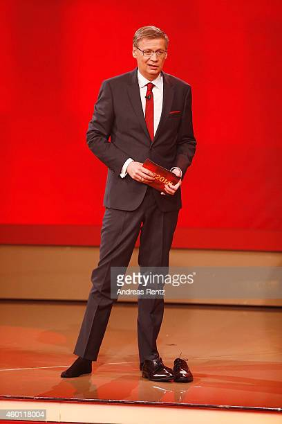 TV host Guenther Jauch moderates without his shoes the 2014 Menschen Bilder Emotionen RTL Jahresrueckblick show on December 7 2014 in Cologne Germany