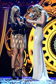 Host Heidi Klum presents the award for Best Look to Taylor Swift onstage during the MTV EMA's 2012 at Festhalle Frankfurt on November 11 2012 in...