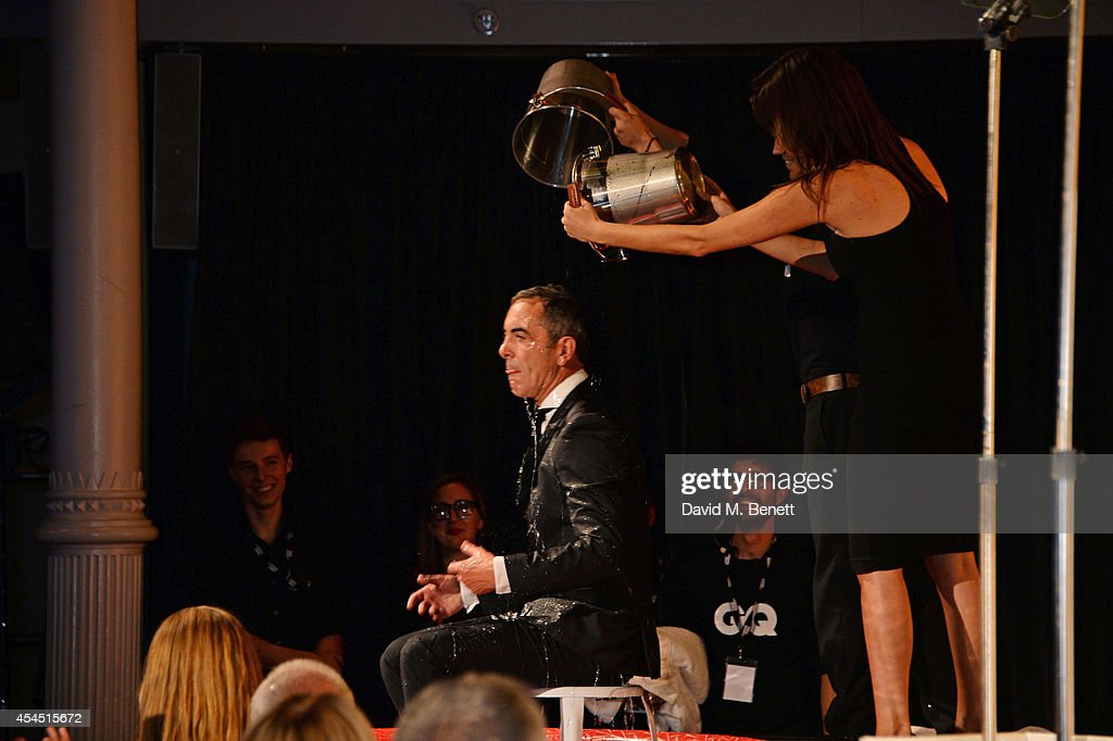 Host James Nesbitt takes the ALS Ice Bucket Challenge at the GQ Men Of The Year awards in association with Hugo Boss at The Royal Opera House on September 2, 2014 in London, England.