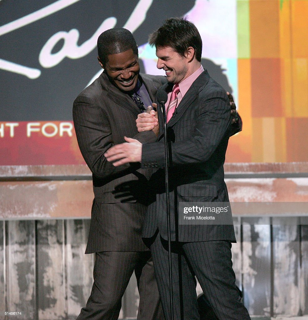 Host <a gi-track='captionPersonalityLinkClicked' href=/galleries/search?phrase=Jamie+Foxx&family=editorial&specificpeople=201715 ng-click='$event.stopPropagation()'>Jamie Foxx</a> and actor <a gi-track='captionPersonalityLinkClicked' href=/galleries/search?phrase=Tom+Cruise&family=editorial&specificpeople=156405 ng-click='$event.stopPropagation()'>Tom Cruise</a> introduce a film clip onstage at CBS' Ray Charles Tribute Concert at the Staples Center on October 8, 2004 in Los Angeles, California.