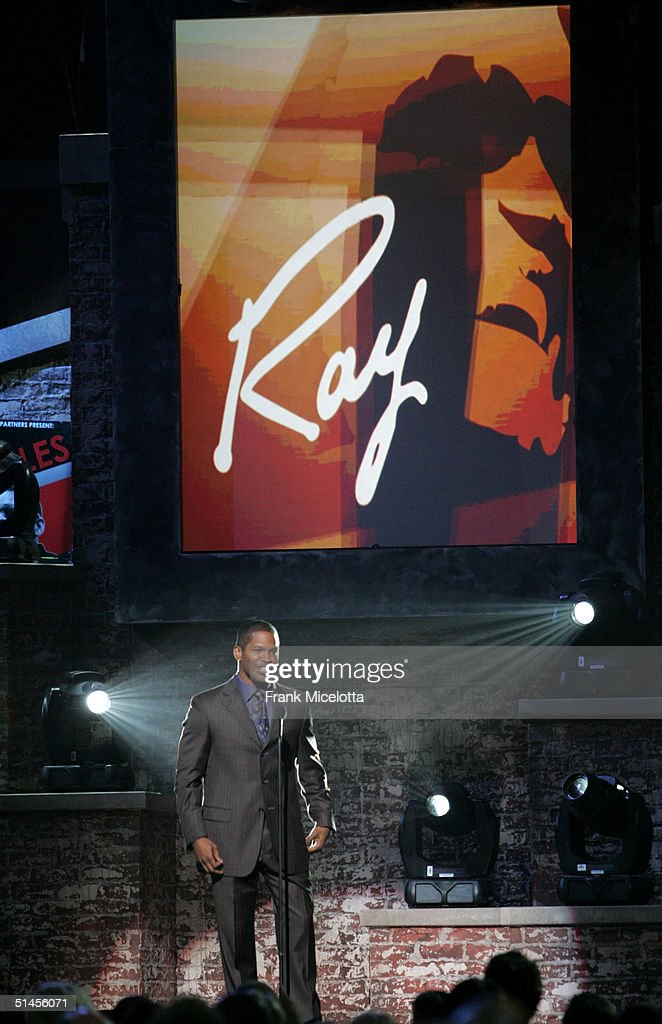 Host Jamie Foxx introduces Kenny Chesney onstage at CBS' Ray Charles Tribute Concert at the Staples Center on October 8, 2004 in Los Angeles, California.
