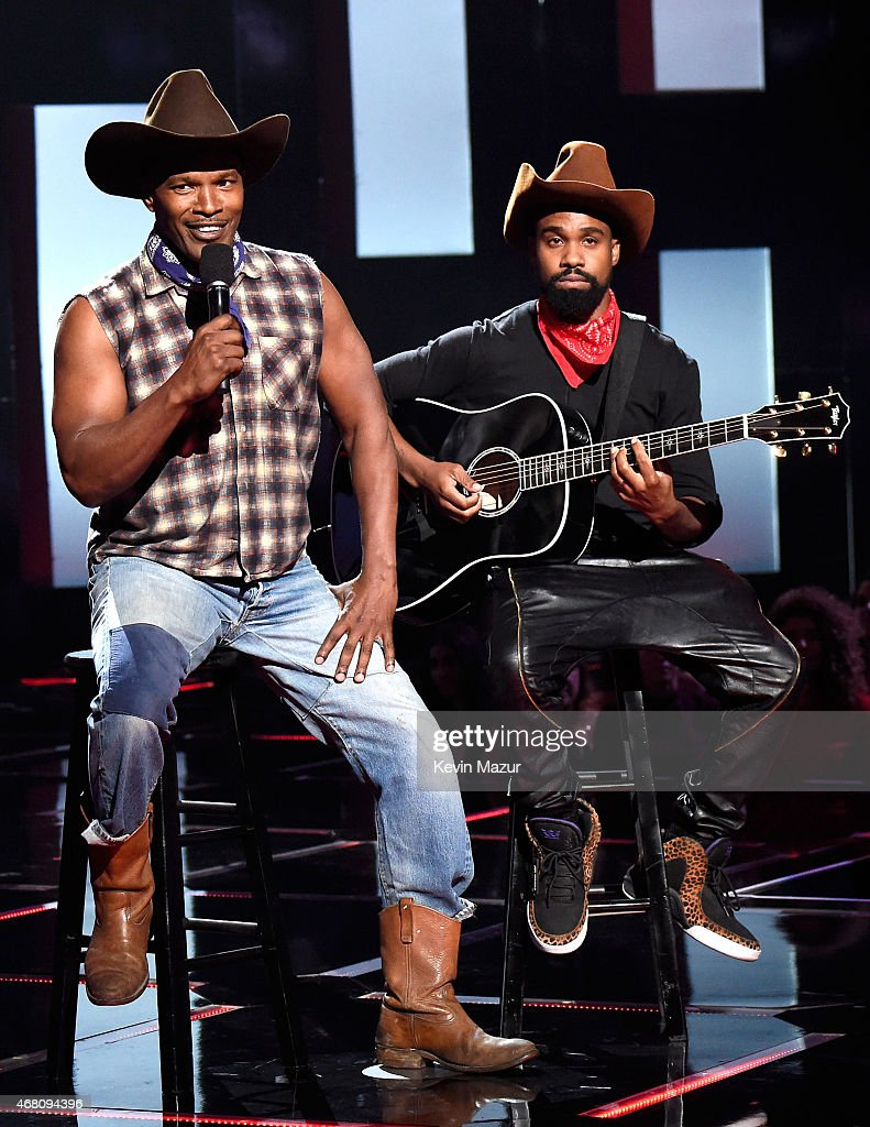 Host Jamie Foxx (L) performs onstage during the 2015 iHeartRadio Music Awards which broadcasted live on NBC from The Shrine Auditorium on March 29, 2015 in Los Angeles, California.