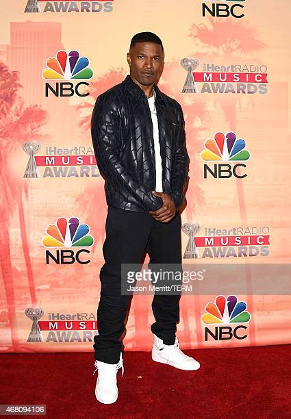 Host Jamie Foxx poses in the press room during the 2015 iHeartRadio Music Awards which broadcasted live on NBC from The Shrine Auditorium on March 29...