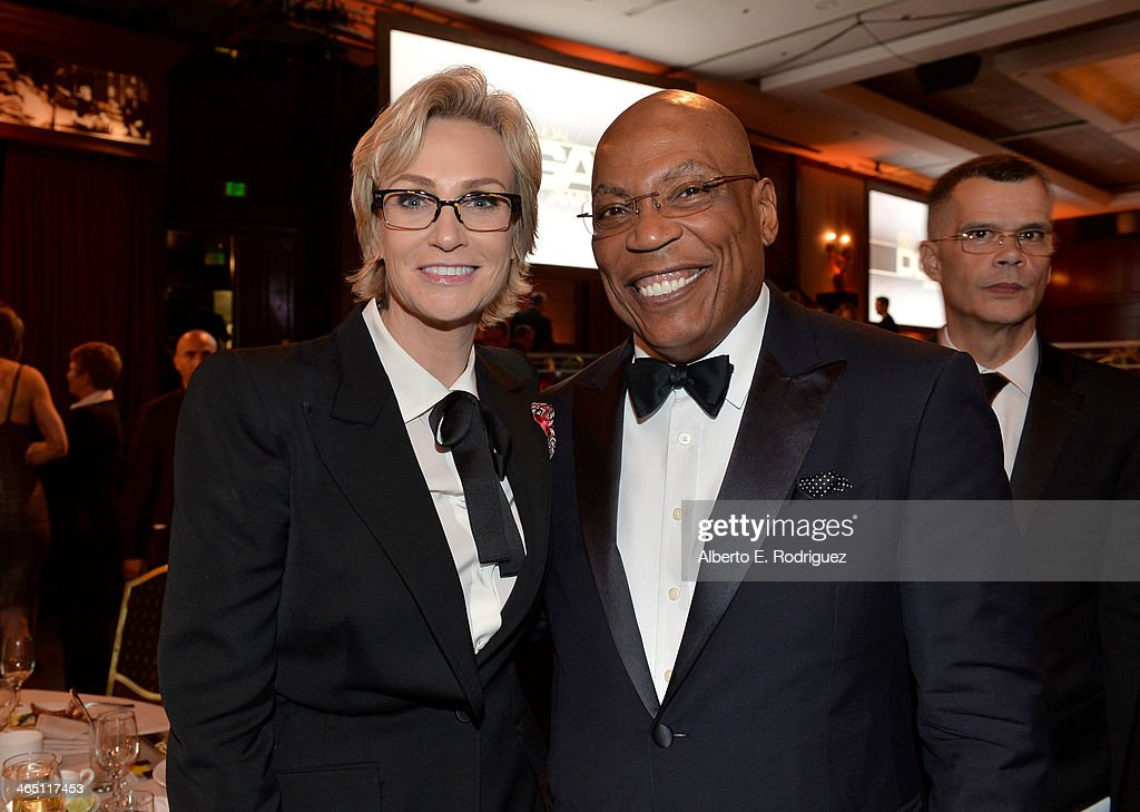 Host Jane Lynch and DGA President Paris Barclay appear at the 66th Annual Directors Guild Of America Awards held at the Hyatt Regency Century Plaza...