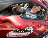 TV host Jay Leno prepares to drive the pace car around the track after the NASCAR Busch Series Hershey's Kissables 300 race at Daytona International...