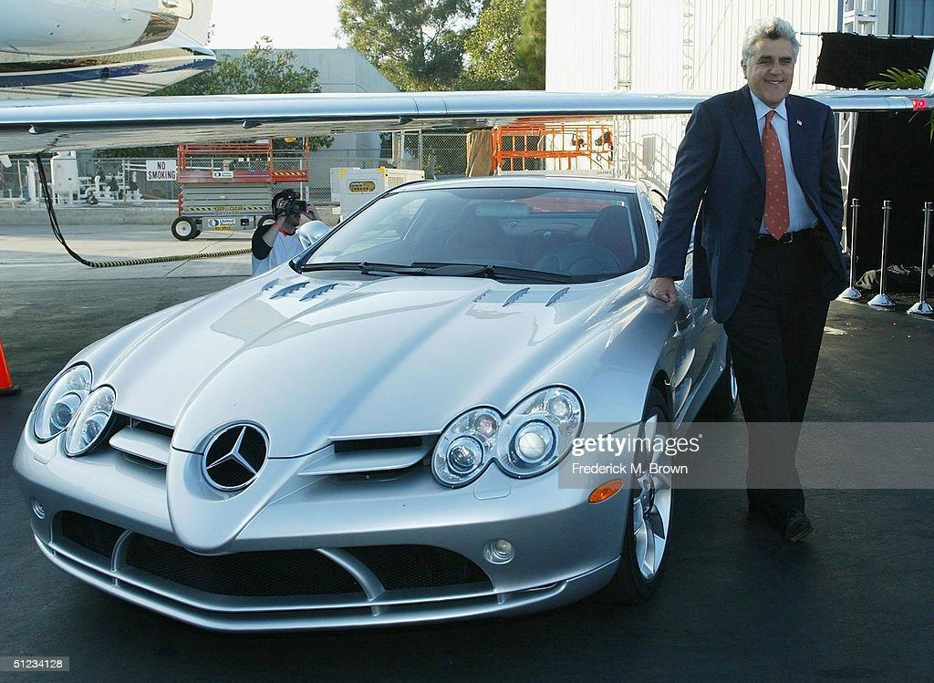 Host Jay Leno stands by his Mercedes SLR during the Robb Report's 'Best of the Best' at Hangar Eight on August 28 2004 in Santa Monica California The...