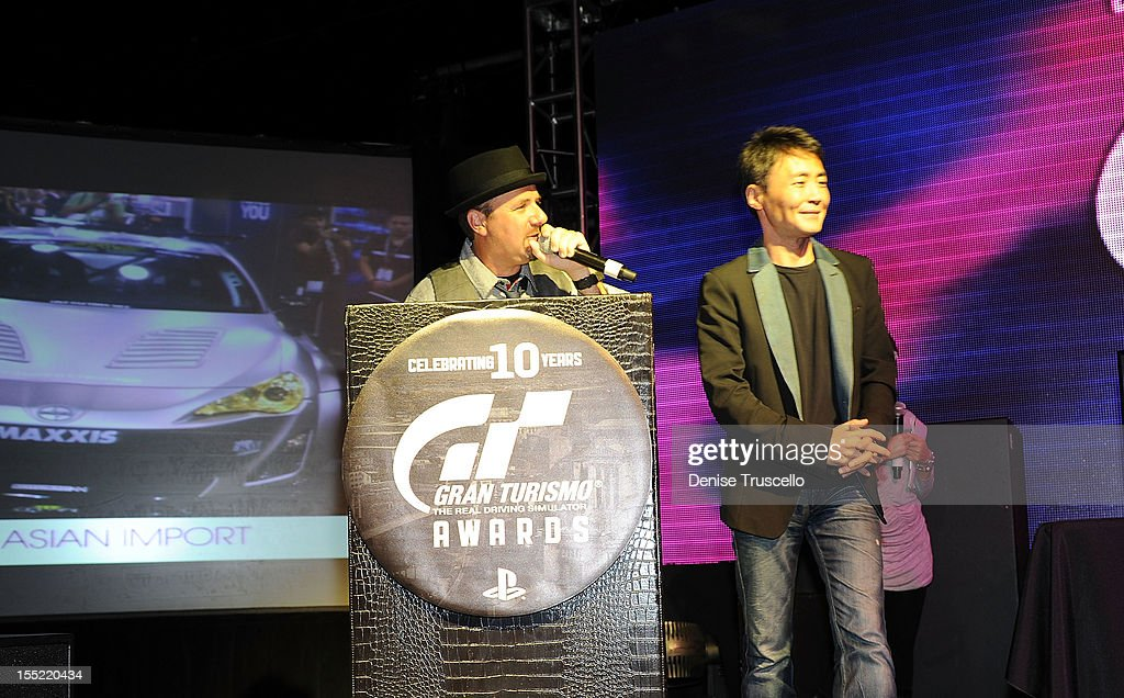 Host Jay Tiles and Gran Turismo creator Kazunori Yamauchi during the 10th Annual Gran Turismo Awards at The Palms Casino Resort on November 1, 2012 in Las Vegas, Nevada.
