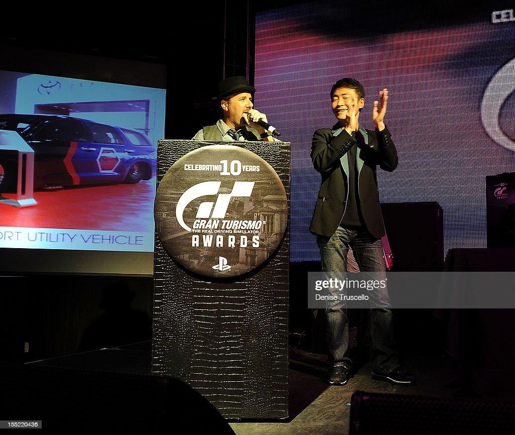 Host Jay Tiles and Gran Turismo creator Kazunori Yamauchi during the 10th Annual Gran Turismo Awards at The Palms Casino Resort on November 1, 2012 in Las Vegas, Nevada.
