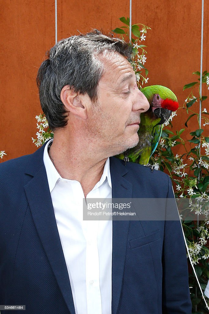 TV Host Jean-Luc Reichmann and parrot Zoe attend the 2016 French Tennis Open - Day Six at Roland Garros on May 27, 2016 in Paris, France.