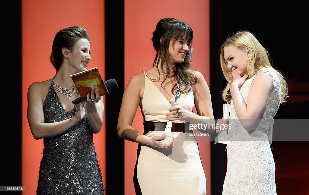 Host Jeannine Michaelsen, Danica Curcic and Maria Dragus on stage at the Shooting Stars stage presentation during the 64th Berlinale International Film Festival at the Berlinale Palast on February 10, 2014 in Berlin, Germany.