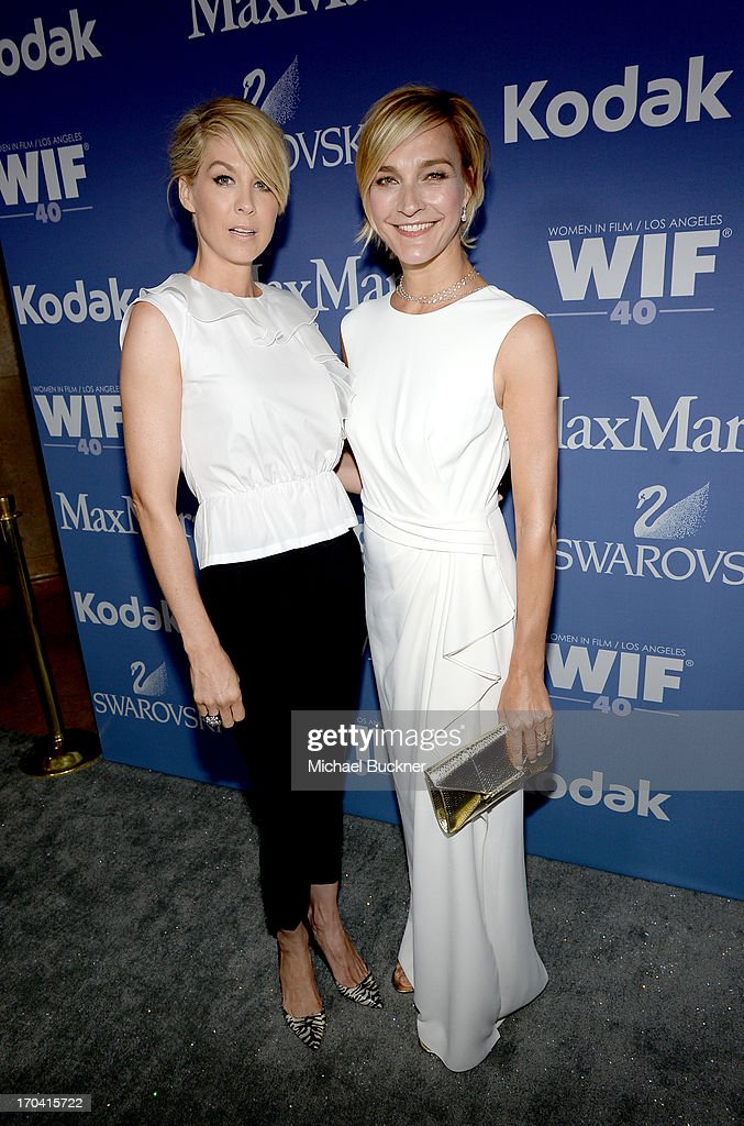 Host Jenna Elfman (L) and Max Mara executive Nicola Maramotti attend Women In Film's 2013 Crystal + Lucy Awards at The Beverly Hilton Hotel on June 12, 2013 in Beverly Hills, California.