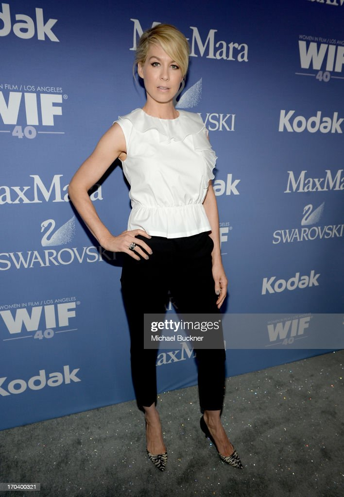 Host <a gi-track='captionPersonalityLinkClicked' href=/galleries/search?phrase=Jenna+Elfman&family=editorial&specificpeople=204782 ng-click='$event.stopPropagation()'>Jenna Elfman</a> attends Women In Film's 2013 Crystal + Lucy Awards at The Beverly Hilton Hotel on June 12, 2013 in Beverly Hills, California.