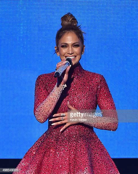Host Jennifer Lopez performs speaks onstage during the 2015 American Music Awards at Microsoft Theater on November 22 2015 in Los Angeles California