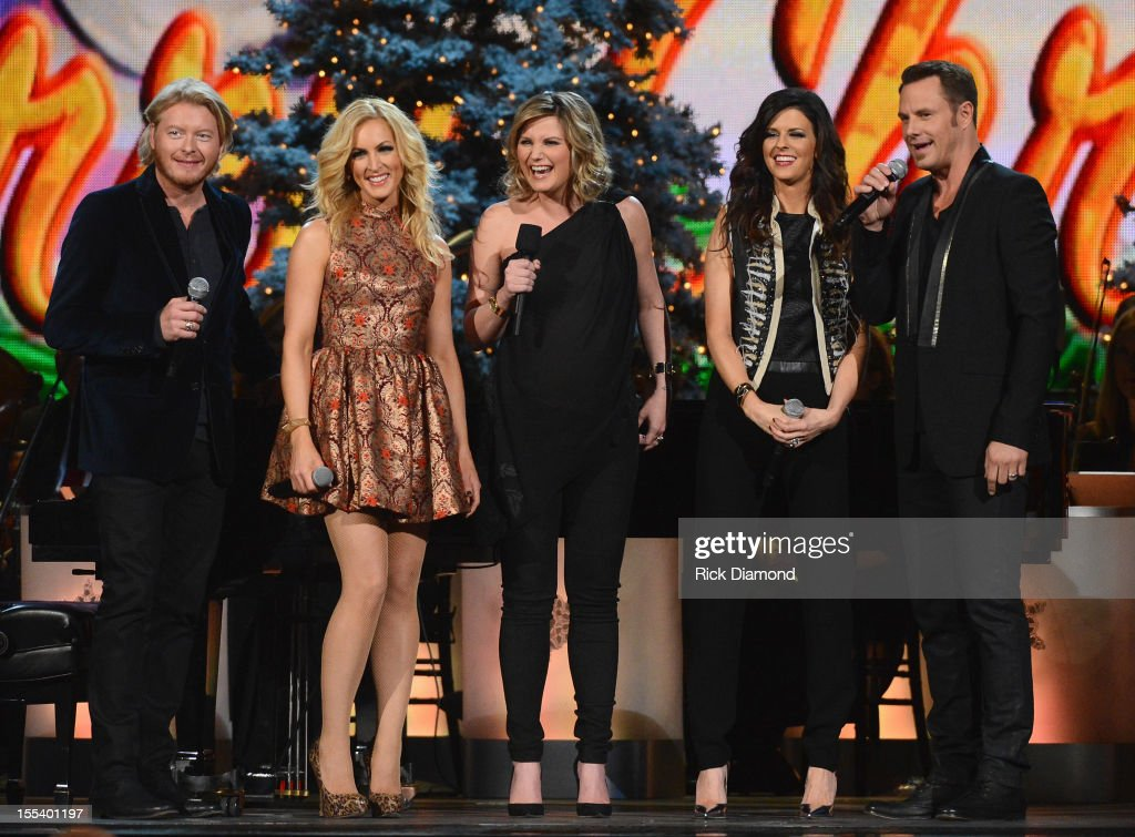 Host <a gi-track='captionPersonalityLinkClicked' href=/galleries/search?phrase=Jennifer+Nettles&family=editorial&specificpeople=619734 ng-click='$event.stopPropagation()'>Jennifer Nettles</a> (center) speaks with Phillip Sweet, Kimberly Schlapman, <a gi-track='captionPersonalityLinkClicked' href=/galleries/search?phrase=Karen+Fairchild&family=editorial&specificpeople=577184 ng-click='$event.stopPropagation()'>Karen Fairchild</a> and <a gi-track='captionPersonalityLinkClicked' href=/galleries/search?phrase=Jimi+Westbrook&family=editorial&specificpeople=619485 ng-click='$event.stopPropagation()'>Jimi Westbrook</a> of Little Big Town during the 2012 Country Christmas concert on November 3, 2012 at the Bridgestone Arena in Nashville, Tennessee. The special airs Thursday, December 20 from 9:00-11:00 p.m., ET on the ABC Television Network.