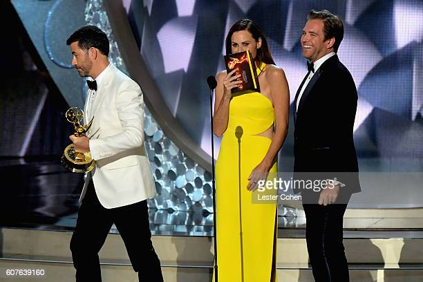 Host Jimmy Kimmel actress Minnie Driver and actor Michael Weatherly speaks onstage during the 68th Annual Primetime Emmy Awards at Microsoft Theater...