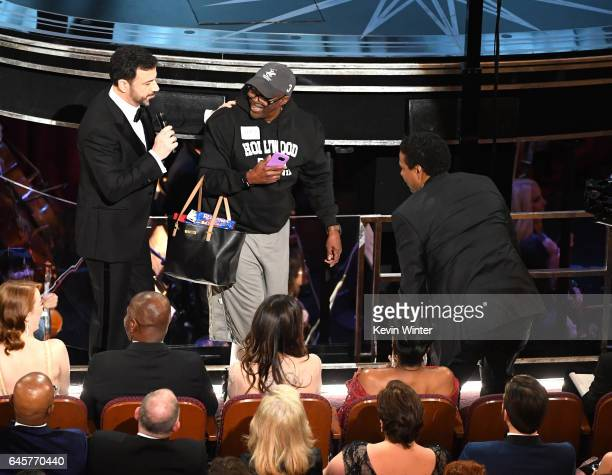 Host Jimmy Kimmel and actor/director Denzel Washington surprise a tourist Gary Coe aka Gary from Chicago during the 89th Annual Academy Awards at...