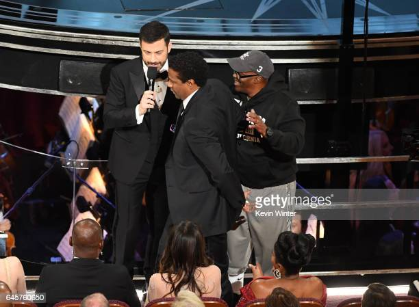 Host Jimmy Kimmel and actor/director Denzel Washington surprise tourist Gary Coe aka Gary from Chicago during the 89th Annual Academy Awards at...