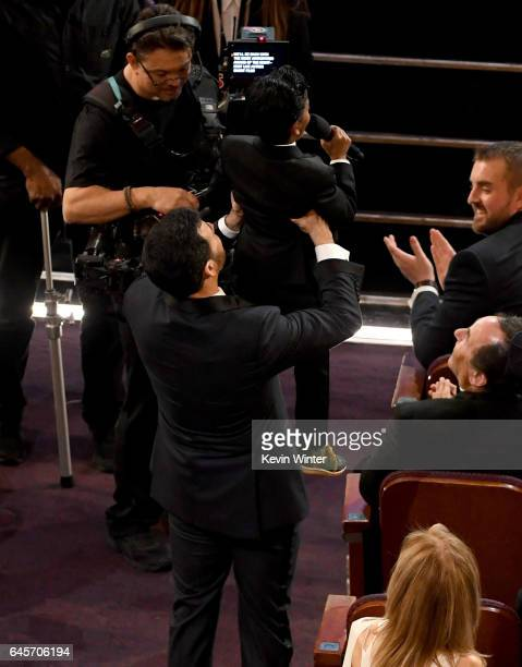 Host Jimmy Kimmel holds up actor Sunny Pawar during the 89th Annual Academy Awards at Hollywood Highland Center on February 26 2017 in Hollywood...