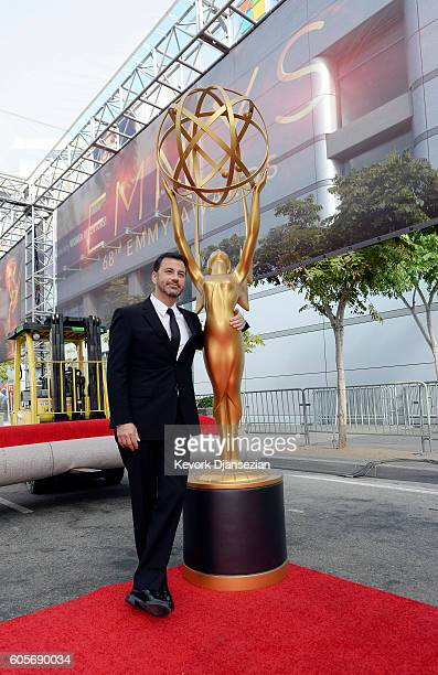 Host Jimmy Kimmel poses with an Emmy statuette during red carpet roll out of he 68th Emmy Awards press preview day at Microsoft Theater on September...
