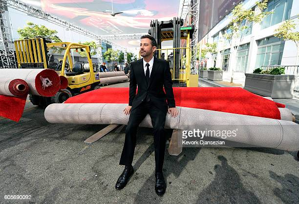 Host Jimmy Kimmel rest on a roll of red carpet during the 68th Emmy Awards press preview day at Microsoft Theater on September 14 2016 in Los Angeles...