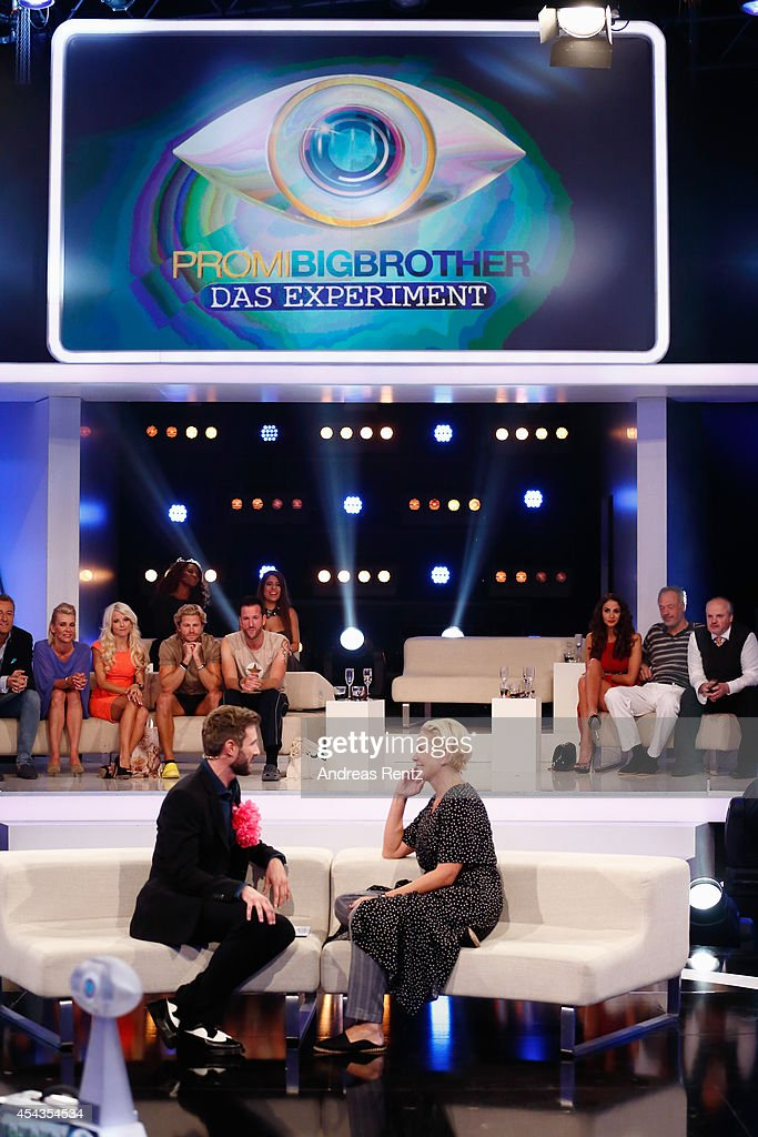 TV host Jochen Schropp chats with second placed Claudia Effenberg during the Promi Big Brother finals at Coloneum on August 29 2014 in Cologne Germany