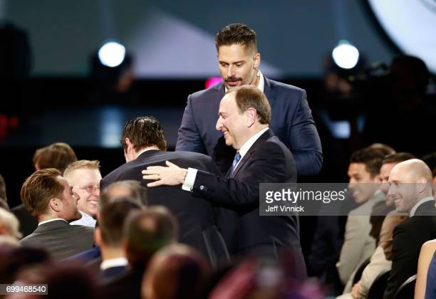 Host Joe Manganiello helps Sidney Crosby switch seats with NHL Commissioner Gary Bettman during the 2017 NHL Awards Expansion Draft at TMobile Arena...