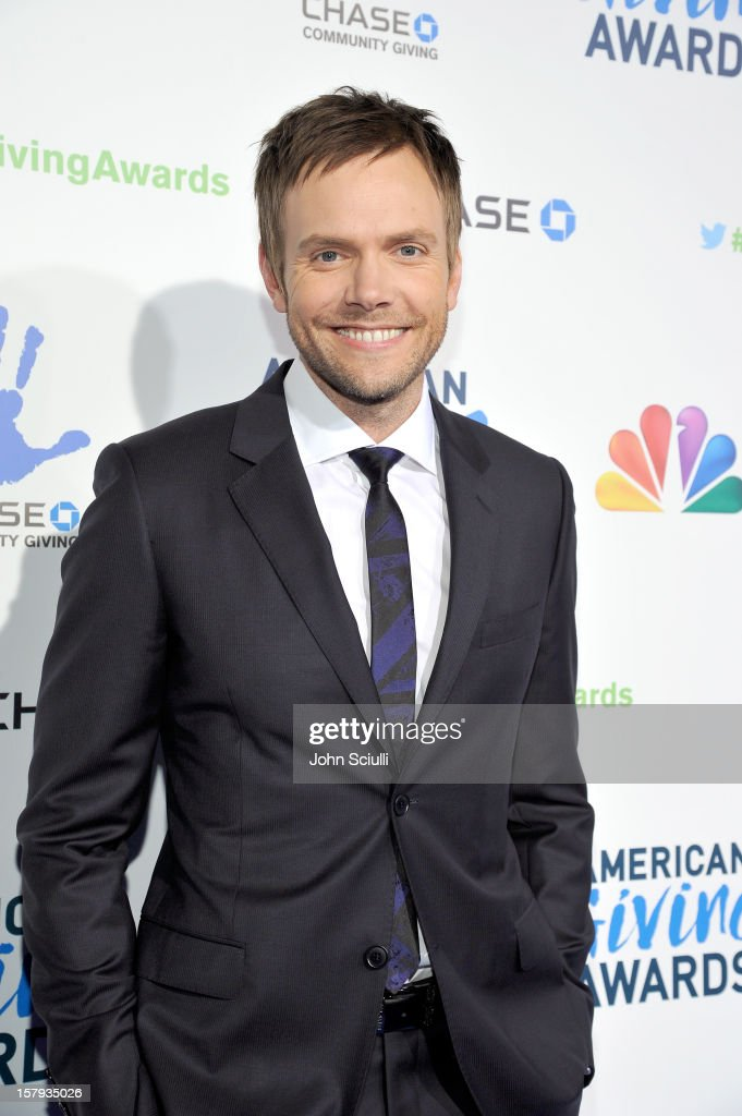 Host <a gi-track='captionPersonalityLinkClicked' href=/galleries/search?phrase=Joel+McHale&family=editorial&specificpeople=754384 ng-click='$event.stopPropagation()'>Joel McHale</a> arrives at the American Giving Awards presented by Chase held at the Pasadena Civic Auditorium on December 7, 2012 in Pasadena, California.
