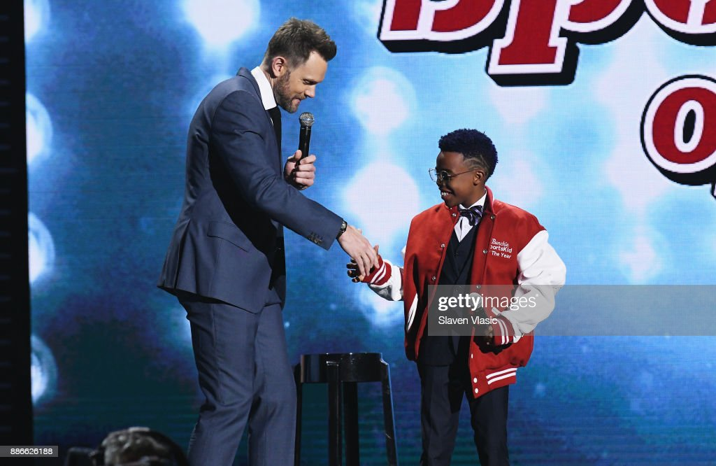 Host Joel McHale presents Bunchie Young with the SI Kids Sportskid of the Year Award during SPORTS ILLUSTRATED 2017 Sportsperson of the Year Show on December 5, 2017 at Barclays Center in New York City. Tune in to NBCSN on December 8 at 8 p.m. ET or Univision Deportes Network on December 9 at 8 p.m. ET to watch the one hour SPORTS ILLUSTRATED Sportsperson of the Year special.