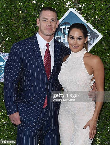 Host John Cena and WWE Diva Nikki Bella arrives at the Teen Choice Awards 2016 at The Forum on July 31 2016 in Inglewood California