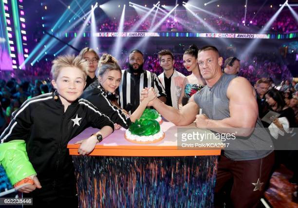 Host John Cena armwrestles onstage at Nickelodeon's 2017 Kids' Choice Awards at USC Galen Center on March 11 2017 in Los Angeles California