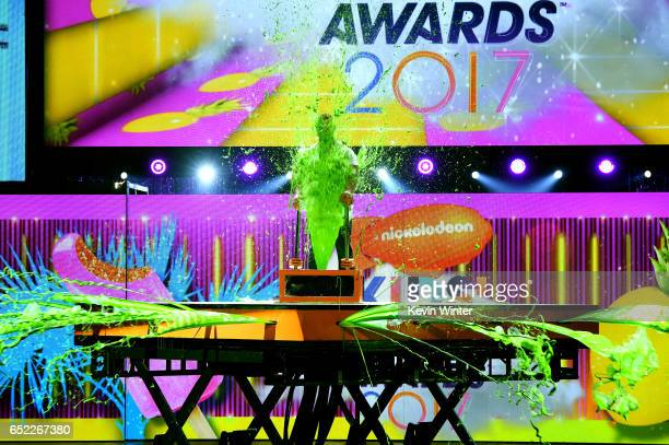 Host John Cena gets slimed onstage at Nickelodeon's 2017 Kids' Choice Awards at USC Galen Center on March 11 2017 in Los Angeles California