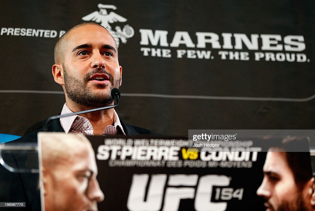 UFC host Jon Anik interacts with media and fans during the final pre-fight press conference ahead of UFC 154 at New City Gas on November 14, 2012 in Montreal, Quebec, Canada.