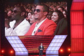 Host Jon Hamm speaks onstage in front of a screenshot of NFL player Colin Kaepernick at The 2013 ESPY Awards at Nokia Theatre LA Live on July 17 2013...