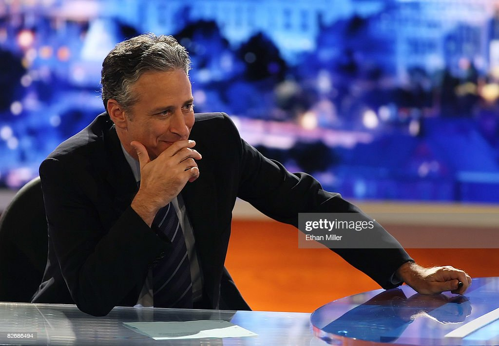 Host <a gi-track='captionPersonalityLinkClicked' href=/galleries/search?phrase=Jon+Stewart+-+Political+Satirist&family=editorial&specificpeople=202151 ng-click='$event.stopPropagation()'>Jon Stewart</a> of Comedy Central's 'The Daily Show with <a gi-track='captionPersonalityLinkClicked' href=/galleries/search?phrase=Jon+Stewart+-+Political+Satirist&family=editorial&specificpeople=202151 ng-click='$event.stopPropagation()'>Jon Stewart</a>' watches a video while taping 'The Daily Show with <a gi-track='captionPersonalityLinkClicked' href=/galleries/search?phrase=Jon+Stewart+-+Political+Satirist&family=editorial&specificpeople=202151 ng-click='$event.stopPropagation()'>Jon Stewart</a>: Restoring Honor & Dignity to the White House' at the McNally Smith College of Music September 5, 2008 in St. Paul, Minnesota. The show is being taped in St. Paul during the week of the Republican National Convention.