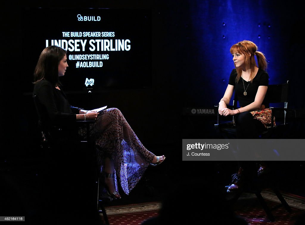 AOL host Jordan Walker and musician Lindsey Stirling speak during the AOL Build Speakers Series at AOL Studios on July 14, 2014 in New York, United States.