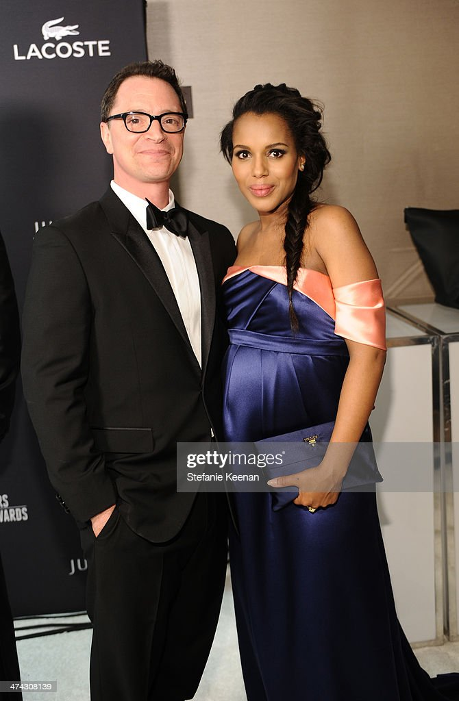 Host Joshua Malina (L) and actress Kerry Washington pose backstage at the 16th Costume Designers Guild Awards with presenting sponsor Lacoste at The Beverly Hilton Hotel on February 22, 2014 in Beverly Hills, California.