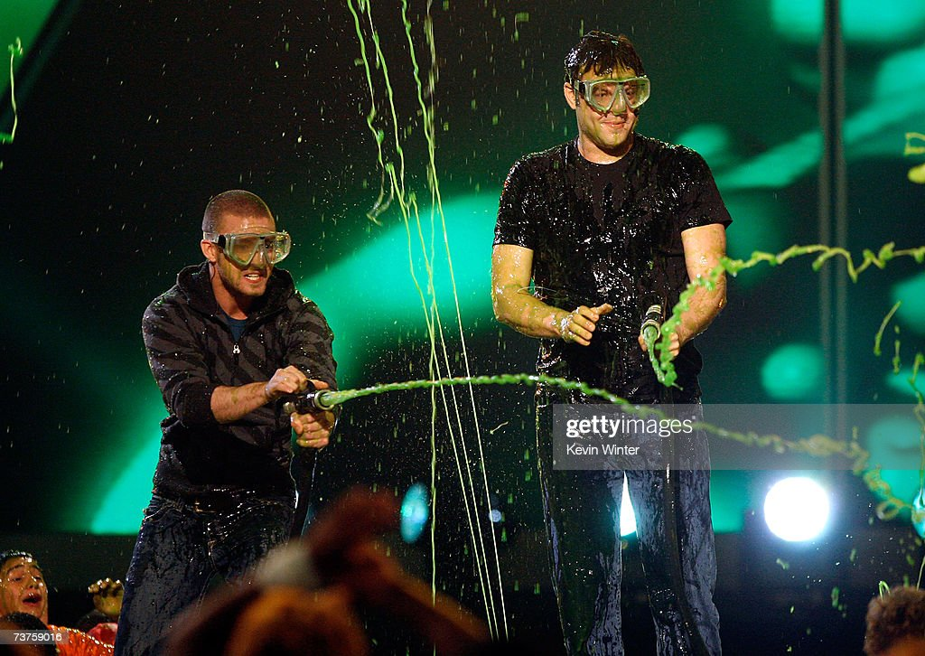 Host Justin Timberlake and actor Vince Vaughn get slimed onstage during the 20th Annual Kid's Choice Awards held at the UCLA Pauley Pavilion on March...