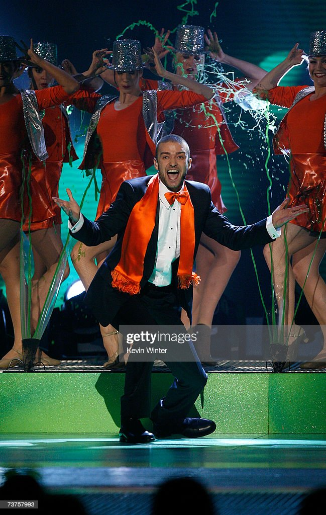 Host Justin Timberlake is slimed while he performs onstage during the 20th Annual Kid's Choice Awards held at the UCLA Pauley Pavilion on March 31...