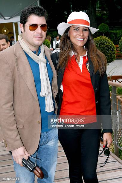 TV host Karine Ferry and her brother David ferry attend the Roland Garros French Tennis Open 2014 Day 3 on May 27 2014 in Paris France