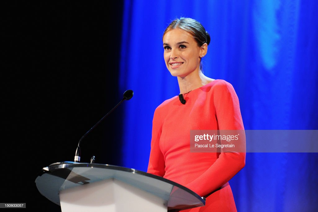 Host Kasia Smutniak speaks on stage during the Opening Ceremony of the 69th Venice International Film Festival at Palazzo del Cinema on August 29...