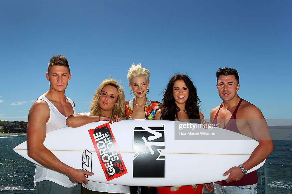 Host Kate Peck (c) joins Scott Timlin, Charlotte Letitia Crosby, Vicky Pattison and James Tindale of UK reality TV series, Geordie Shore, for a photo at Bondi Beach on March 5, 2013 in Sydney, Australia.