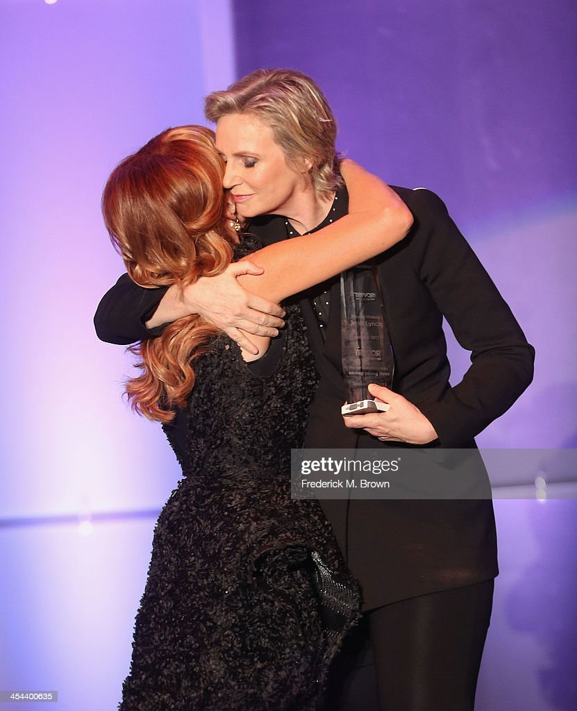 Host <a gi-track='captionPersonalityLinkClicked' href=/galleries/search?phrase=Kathy+Griffin&family=editorial&specificpeople=203161 ng-click='$event.stopPropagation()'>Kathy Griffin</a> and honoree <a gi-track='captionPersonalityLinkClicked' href=/galleries/search?phrase=Jane+Lynch&family=editorial&specificpeople=663918 ng-click='$event.stopPropagation()'>Jane Lynch</a> speak onstage at 'TrevorLIVE LA' honoring <a gi-track='captionPersonalityLinkClicked' href=/galleries/search?phrase=Jane+Lynch&family=editorial&specificpeople=663918 ng-click='$event.stopPropagation()'>Jane Lynch</a> and Toyota for the Trevor Project at Hollywood Palladium on December 8, 2013 in Hollywood, California.