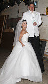 TV host Kelly Ripa is seen in her Halloween costume as Kim Kardashian with musician Nick Lachey as Kris Humphries at the ABC TV studios on October 31...