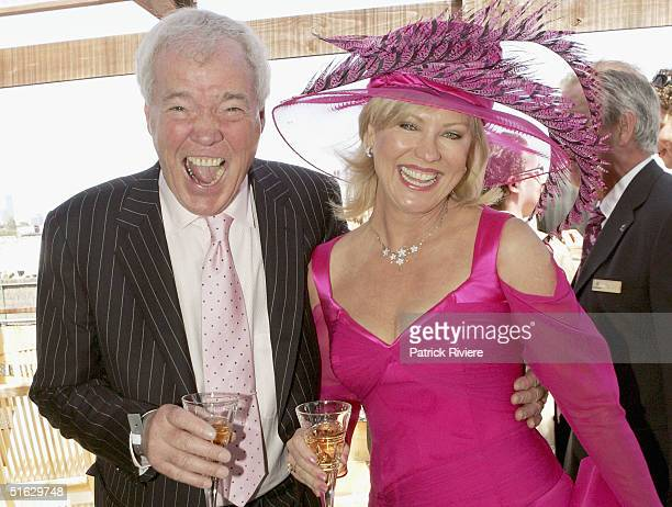 TV host Kerri Anne Kennerley and husband John attend the Melbourne Cup Carnival's Derby Day in the Emirates marquee at Flemington October 30 2004 in...