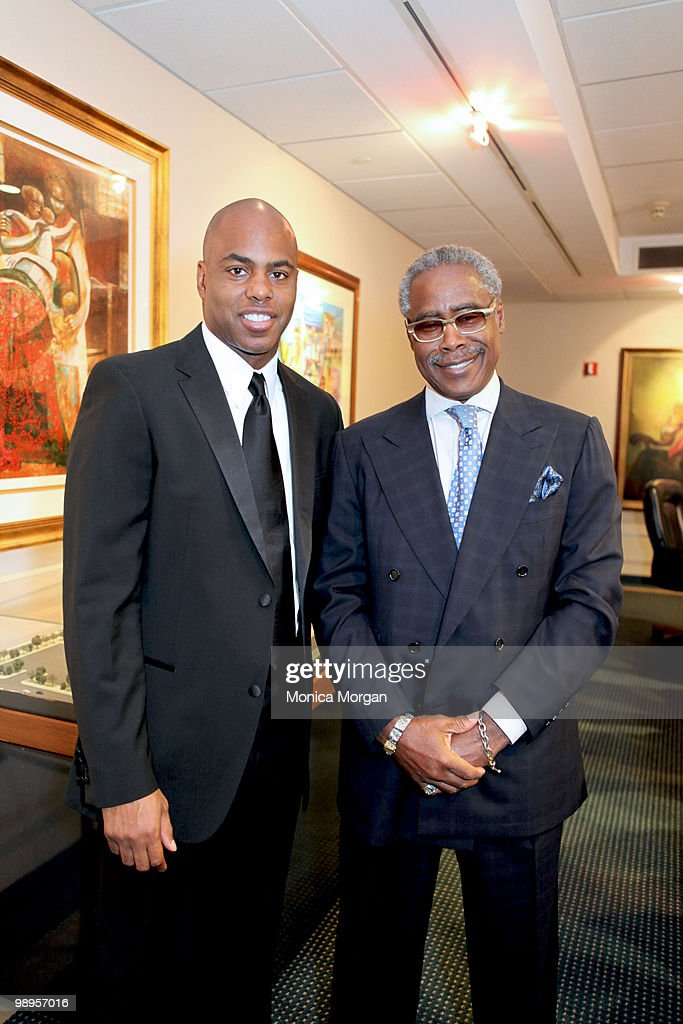 TV host Kevin Frazier and Ed Lewis, Founder and Chairman Emeritus, Essence Magazine, who accepted on behalf of the John H. Johnson family, backstage at the 12th Annual Ford Freedom Awards Scholars Lecture at the Charles H. Wright Museum of African American History on May 6, 2010 in Detroit, Michigan.