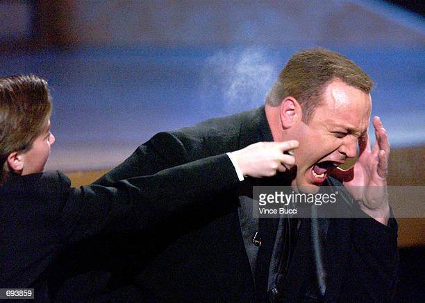 Host Kevin James gets pepper sprayed on stage during the 28th Annual Peoples Choice Awards at the Pasadena Civic Center January 13 2002 in Pasadena CA