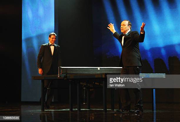 Host Kevin Spacey plays table tennis with Rafael Nadal during the award ceremony for the 2011 Laureus World Sports Awards at the Emirates Palace on...