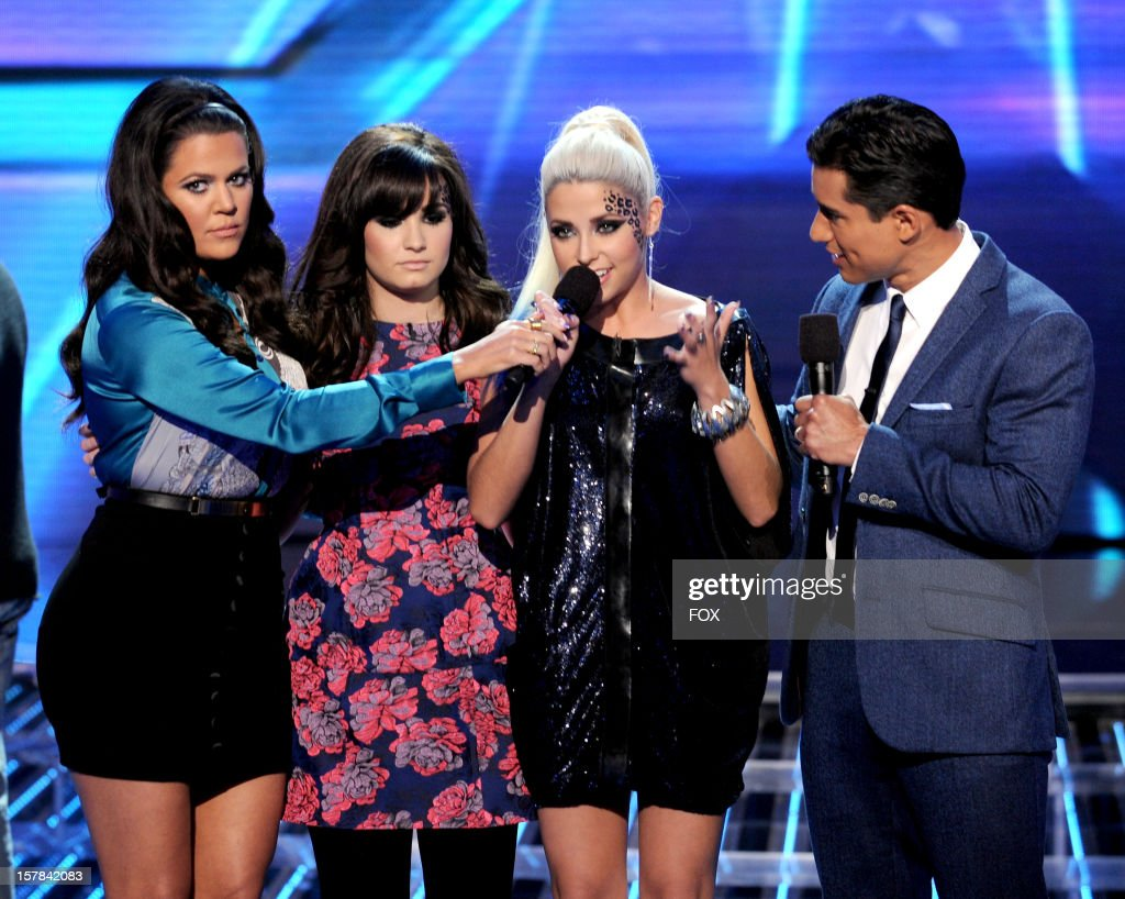 Host Khloe Kardashian judge Demi Lovato eliminated contestant CeCe Frey and host Mario Lopez onstage at FOX's 'The X Factor' Season 2 Top 6 to 4 Live...