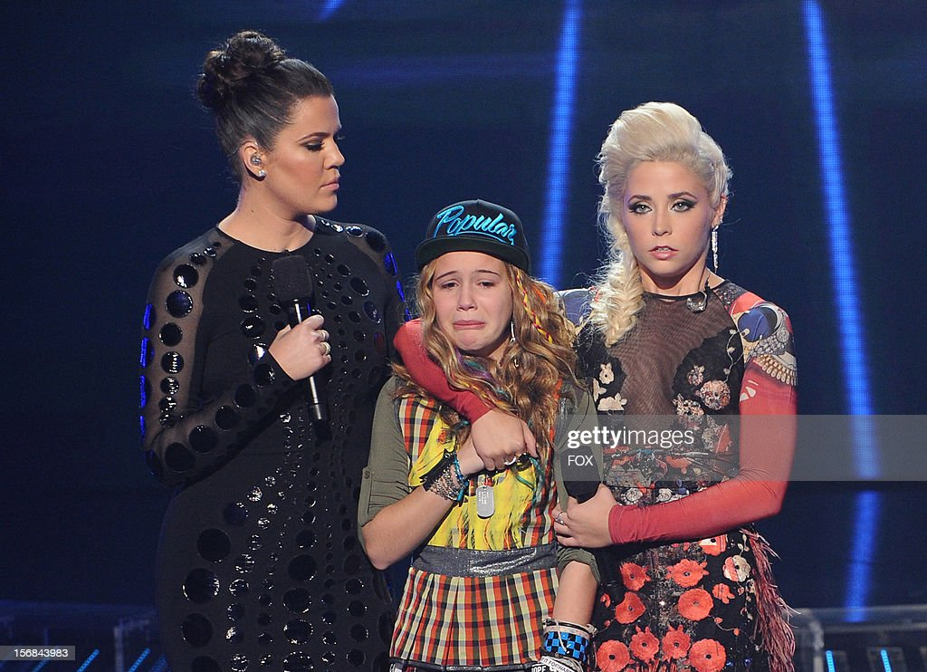 Host Khloe Kardashian Odom and contestants Beatrice Miller and Cece Frey onstage at FOX's 'The X Factor' Season 2 Top 10 to 8 Live Elimination Show on November 22, 2012 in Hollywood, California.
